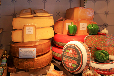 AMSTERDAM, NETHERLANDS - MAY 3, 2016: Display of traditional Dutch cheese, like Edam and Gouda cheese on a table at local cheese shop, Amsterdam, the Netherlands