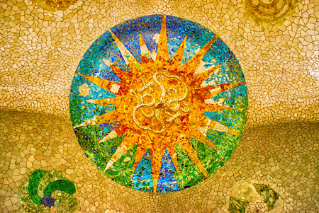Ceiling with a sun mosaic at the Parc Guell designed by Antoni Gaudi, Barcelona, Spain. 写真素材