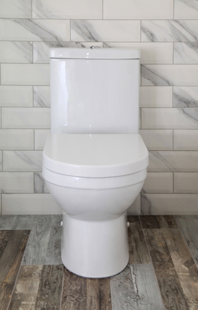 White toilet bowl in modern bathroom, selective focus