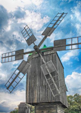 Old wooden windmill on blue sky background, Ukraine Stock Photo