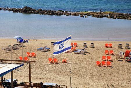 Israeli flag on the empty beach, Tel Aviv, Israel