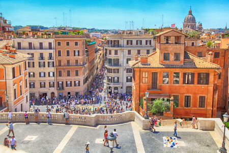 ROME, ITALY - JULY 16, 2017: Tourists on Spanish Steps and Square of Spain (Piazza di Spagna) - popular place in Rome, Italy. View from above