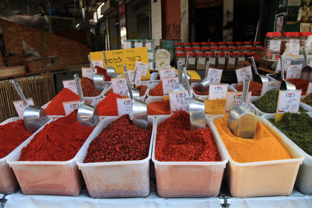 Colorful variety of spices on display in food market in Tel Aviv, Israel. Stock Photo