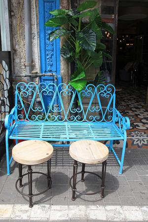 couch: Vintage blue iron furniture at Jaffa flea market district in Tel Aviv-Jaffa, Israel.