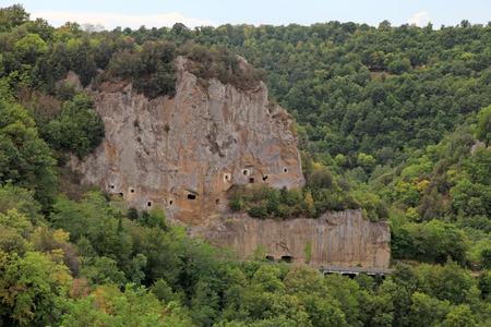 Lanscape with cave carved in the tuff rock near Sorano, Maremma, Tuscany, Italy Stock Photo