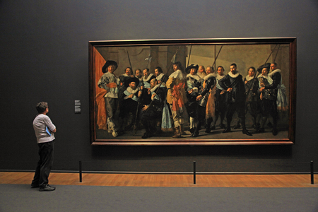 frans: AMSTERDAM, THE NETHERLANDS - MAY 4, 2016: Visitors and The Meagre Company (1637) by Frans Hals at the famous Rijksmuseum in Amsterdam, Netherlands. Editorial