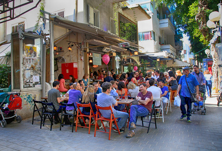 TEL AVIV, ISRAEL - APRIL 1, 2016: People in outdoor cafe on Dizengoff Street in Tel Aviv, Israel.