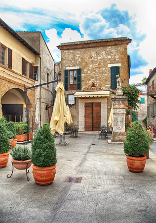 PITIGLIANO, ITALY - JULY 26, 2017: Cafe in the historic center of gorgeous etruscan and medieval town Pitigliano built of tuff stone, Grosseto, Tuscany, Italy. Called little Jerusalem for the historical presence of a Jewish community
