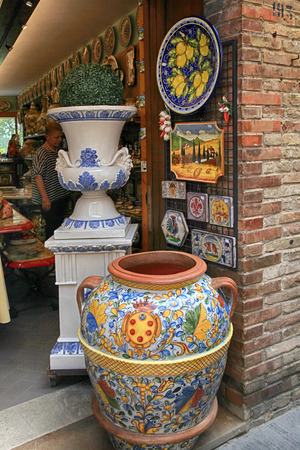 shop window: SAN GIMIGNANO, ITALY - JULY 22, 2017 : Shop with majolica ceramics at the medieval town of San Gimignano, Siena, Tuscany, Italy. Colourful pottery is a popular souvenir for tourists and is sold throughout the town of San Gimignano.