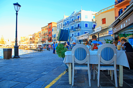 seafronts: Sidewalk street cafe in Chania waterfront on Crete island, Greece.