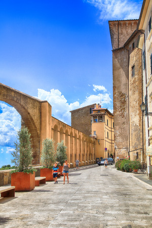 PITIGLIANO, ITALY - JULY 26, 2017: The historic center of gorgeous etruscan and medieval town Pitigliano built of tuff stone, Grosseto, Tuscany, Italy. Called little Jerusalem for the historical presence of a Jewish community Editorial