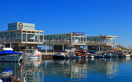 LIMASSOL, CYPRUS - JANUARY 9, 2018: View of the Limassol Old Port with modern restaurants and yachts, Limassol Marina, Cyprus