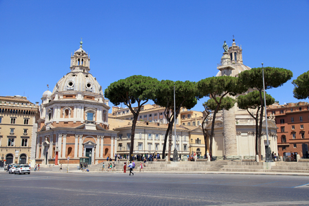 ROME, ITALY - JULY 17, 2017: View of Venice Square (Piazza Venezia) with Santa Maria di Loreto abbey, Rome, Italy. Piazza Venezia is located in heart of Rome, surrounded by several landmarks, including Palazzo Venezia and Vittoriano Monument.