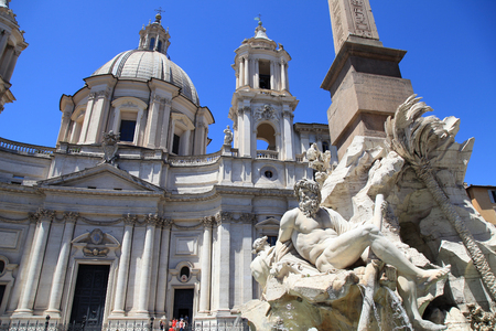 Santa Agnese Church and the beautiful Bernini's Fountain of Four River in the center of Piazza Navona Square, Rome, Italy  Editoriali