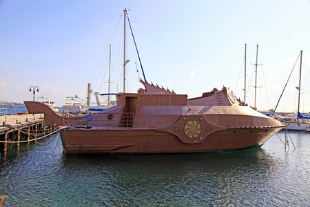 PAPHOS, CYPRUS - JANUARY 12, 2018: Nautilus underwater simulator touristic travel boat moored in Paphos port, Cyprus. Paphos is a coastal popular summer tourist resort city in the southwest of Cyprus.