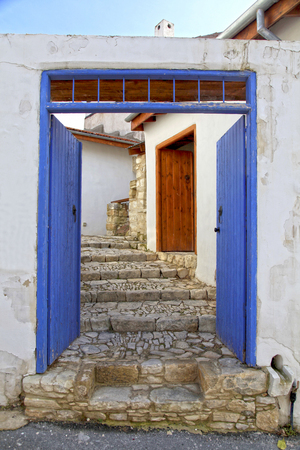 Blue door and stone steps in the old village of Laneia, Limassol district, Cyprus