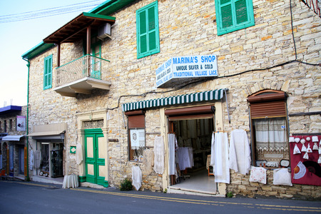 PANO LEFKARA, CYPRUS - JANUARY 9, 2018: Cityscape with traditional souvenir shop with hand made laces in old village Pano Lefkara, Cyprus.