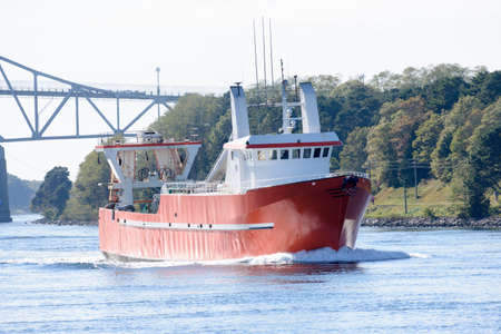 Commercial fishing vessel that just passed under the Bourne Bridge while traveling through the Cape Cod Canal.