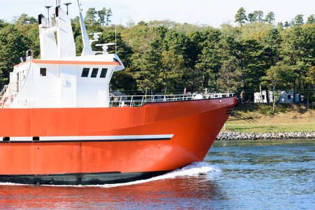 Commercial fishing vessel traveling through the Cape Cod Canal. Фото со стока