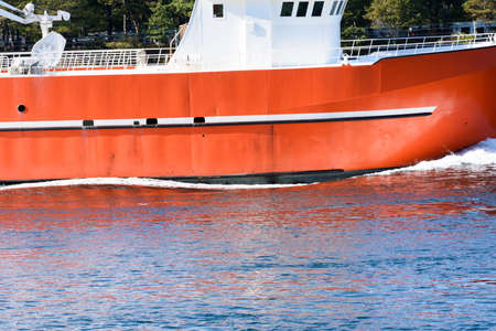 Commercial fishing vessel traveling through the Cape Cod Canal. Stock Photo