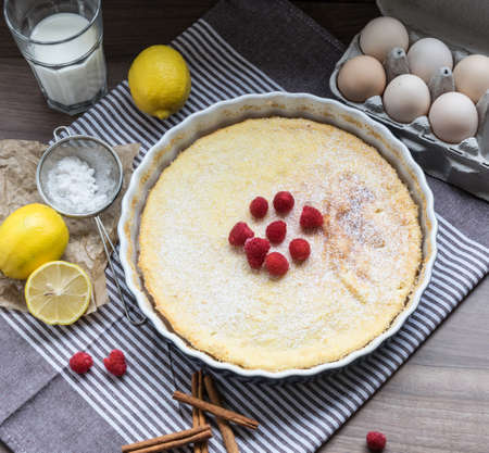 Homemade cheesecake with raspberries and lemon. Delicate dessert for coffee