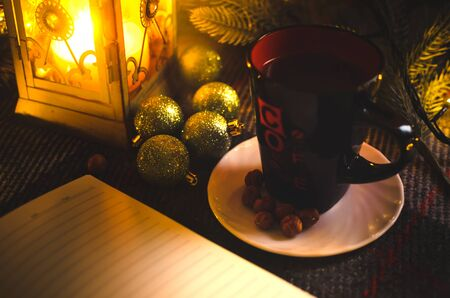 A cup of coffee in a cozy New Years Christmas decoration in a warm light and pleasant atmosphere Stock Photo