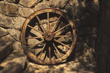 Old vintage cart wheel on an entourage background travel