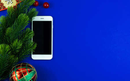A series of photos on a blue background with a smartphone, template, fir branches, layout Stock Photo