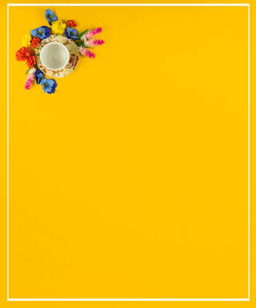 A series of photographs with beautiful compositions on a yellow background on the theme of relaxation, tea drinking, cozy still lifes with flowers and a decorative set, a cup and saucer