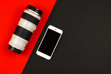 Modern concept comparing smartphone camera and DSLR lens and mobile phone, background, place for text, copy space photo