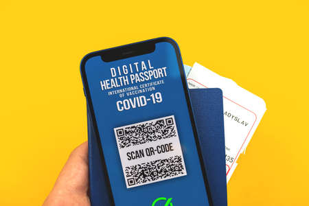 Health passport that shows COVID-19 test results, concept of new normal travel, yellow background