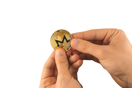 Man holds Monero coin in hands isolated on white background, cryptocurrency Stock Photo