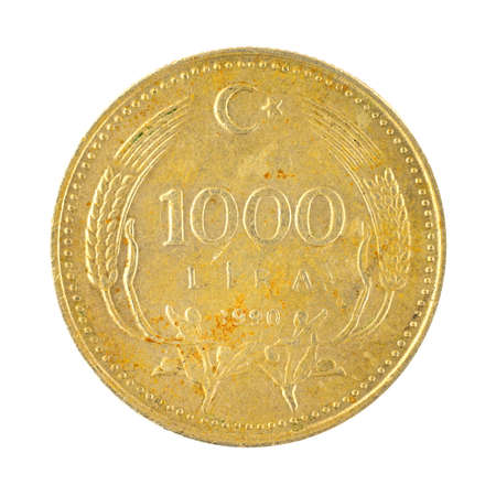 Old and rusty 1000 Lira coin, Turkey money isolated on a white background photo