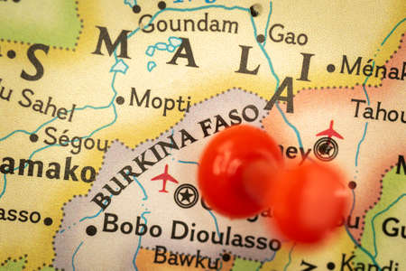Location Burkina Faso, map with push pin closeup, travel and journey concept with marker, Africa