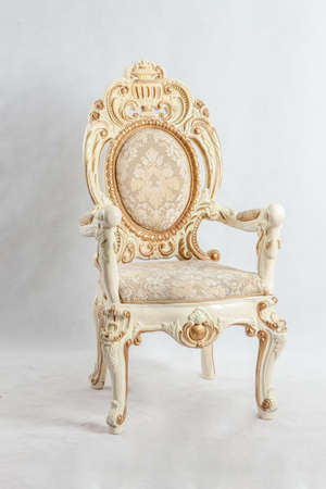 Old chair with expensive patterns. Use gold and floral pattern.