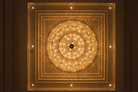 image  crystal chandelier whith Spherical.Crystal made chandeliers light orange.On the ceiling .Select focus point