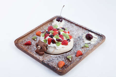 Eating style pouring cream on the meringue. Red Berry & Green Kiwi fruit and apple Add color to your eating page More decorations with Free cherry blossoms on whipped cream and cookies socket The cart 写真素材
