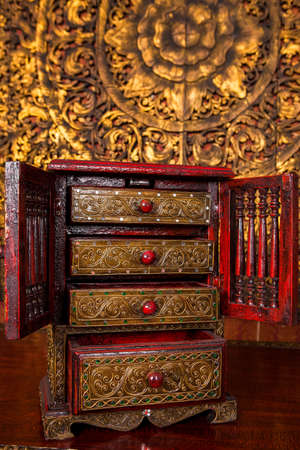 Thai style cabinet is old.Made of carved wood, Thai pattern