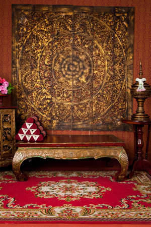 Ancient Thai scenes in a photo studio.The wood is carved into beautiful patterns.Consists of a table, cabinet, water bowl