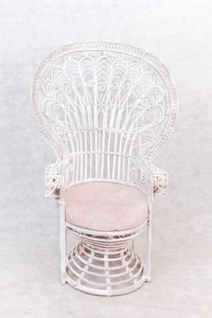 White round wooden chair, leather seat and White rattan on white background Seat covered with leather
