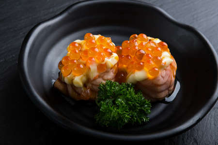 Creative Japanese food.It my neam Salmon Grilled roe ball.Add salmon roe and mayonnaise sauce 免版税图像