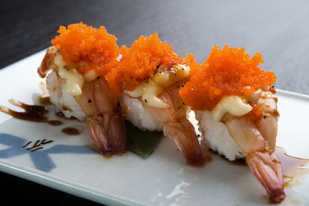 Creative Japanese food menu,sushi Steamed shrimp.Mix mayonnaise and shrimp eggs.On a classic white ceramic plate
