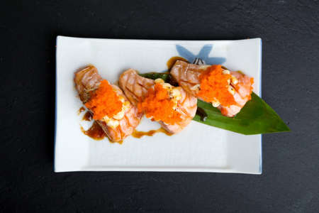 Creative Japanese food menu,sushi Simon Grill.Mix mayonnaise and shrimp eggs.On a classic white ceramic plate