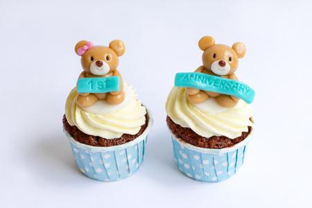 red velvet cupcake: Anniversary cupcakes on white background