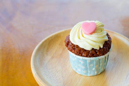 red velvet: Red velvet cupcake on a wood plate