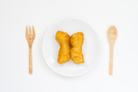 patongkoh: Chinese dessert ; deep fried dough stick with cute spoon and fork on white background