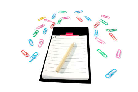 pencil on the notepad with black frame and colorful clips around on white background. Isolate.