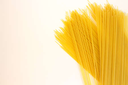 raw yellow long spaghetti isolated on white background.