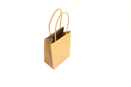 Opend brown paper shopping bag with hands isolated on white background. Levitation on white.