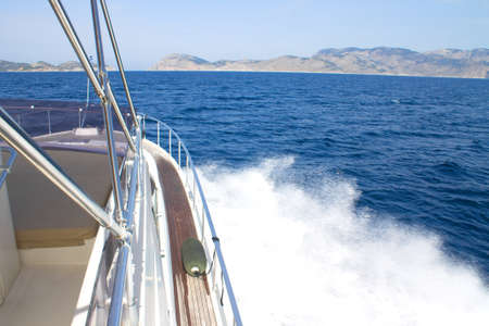 side front of the motor yacht going to the sea towards the mountains. Luxury traveling life. Banco de Imagens